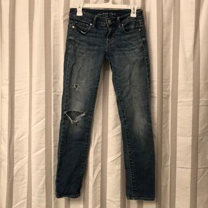 Low rise AE jeans distressed and broken in